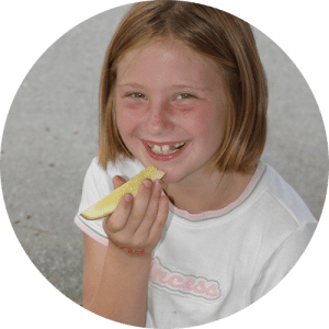 Girl Eating Pickle Spear at Lake Winnie in Chattanooga