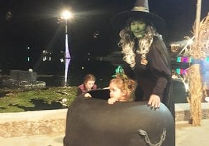 Witch and Child at Lake Winnie During Halloween